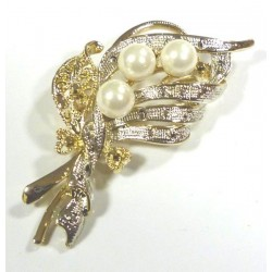 Brooch with gold and silver...