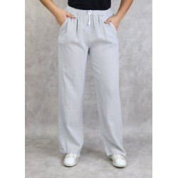 White linen trousers with...